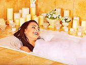 Woman relaxes at bubble bath. — Stock Photo