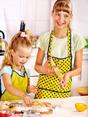 Children with rolling-pin dough — Stock Photo