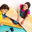 Family laying parquet at home — Stock Photo #39262883