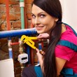 Woman builder with special tool. — Stock Photo