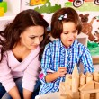 Stock Photo: Family with child playing bricks.