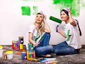 Woman paint wall at home. — 图库照片