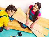 Family laying parquet at home — Stock Photo