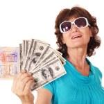 Senior woman holding passport and money. — Stock Photo #3955730