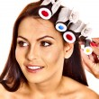 Woman wear hair curlers on head. — Stock Photo #39698945