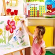 Child painting at easel. — Stock Photo #39699087