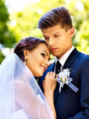 Groom embrace bride . — Stock Photo