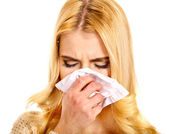 Young woman with handkerchief having cold. — Stock Photo