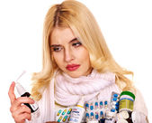 Young woman using throat spray. — Stock Photo