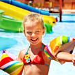 Child playing in swimming pool — Stock Photo