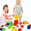 Stock Photo: Children play building blocks