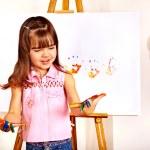 Child making hand prints — Stock Photo