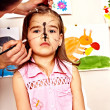 Stock Photo: Child preschooler with face painting