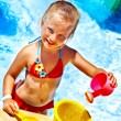 Child with bucket in pool — Stock Photo #40153773