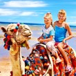 Stock Photo: Tourists riding camel