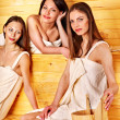 Girlfriends relaxing in sauna — Stock Photo