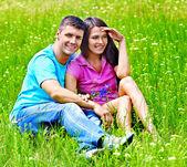 Couple on green grass — Stock Photo
