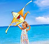 Child flying kite — Stock Photo