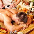 Man getting stone therapy massage . — Stock Photo