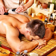 Stock Photo: Mgetting stone therapy massage .