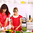 Stock Photo: Mother and daughter cooking at kitchen.