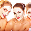 Stock Photo: Group women with facial mask.
