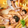 Man and woman getting herbal ball massage in spa. — Stock Photo