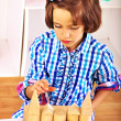 Child playing bricks. — Stock Photo #40598145