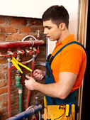 Men builder fixing heating system . — Stock Photo