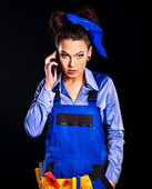 Woman builder calling mobile phone. — Stock Photo
