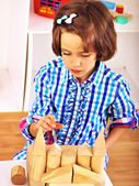 Child playing bricks. — Stock Photo