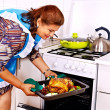 Mature woman preparing chicken — Stock Photo #41016879