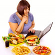 Stock Photo: Womeating junk food.