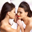Two sexy lesbian women erotic foreplay game in bed. — Stock Photo