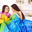 Lesbian women at erotic foreplay game in bed. — Stock Photo