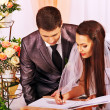 Stock Photo: Groom and bride register marriage