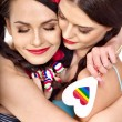 Stock Photo: Two lesbiwomen with heard  in erotic foreplay game