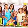 Happy family with child and grandparent cooking at kitchen. — Stock Photo #42402915