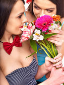 Two sexy lesbian women with flower. — Foto de Stock