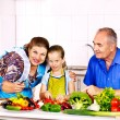 Family with child cooking at kitchen. — Stock Photo #42854235