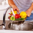 Man washing fruit at kitchen. — Stock Photo #42854245