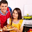Young family cooking pizza at kitchen. — Stock Photo #42854267