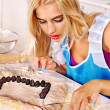 Girl baking cookies in the oven — Stock Photo #42854337