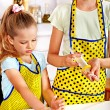 Child with rolling-pin dough — Stock Photo