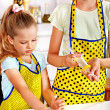 Child with rolling-pin dough — Stock Photo #42854345