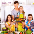 Happy family with grandmother at kitchen. — Stock Photo #42854661
