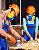 People in builder helmet . — Stock Photo