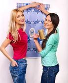 Women glues wallpaper at home. — Stock Photo
