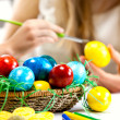 Children paint Easter eggs at home. — Stock Photo #43932117