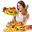 Woman choosing between fruit and hamburger. — Stok fotoğraf #44263703